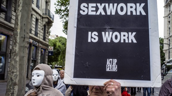 Prostitutes wearing masks demonstrate, on May 29, 2013 in Lyon, to denounce their working conditions and police repression.