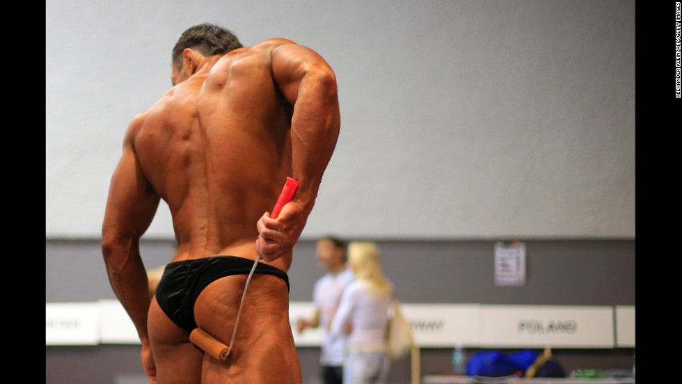 A competitor prepares backstage at the World Classic Bodybuilding Championship and Bikini-Fitness World Cup in St Polten, Austria, on November 16.
