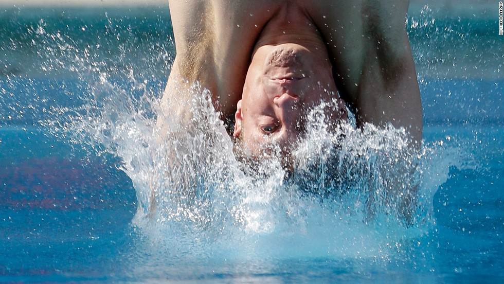 Dwight Dumais hits the water as he competes in the preliminary round of the men's 3-meter springboard event at the USA Diving Grand Prix on May 10 in Fort Lauderdale, Florida.