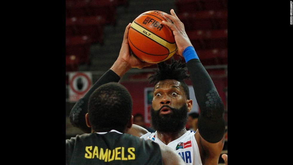 Yack Martinez of the Dominican Republic moves the ball past Jamaica's Samardo Samuels during a FIBA World Cup qualifying game on September 5 in Caracas, Venezuela.