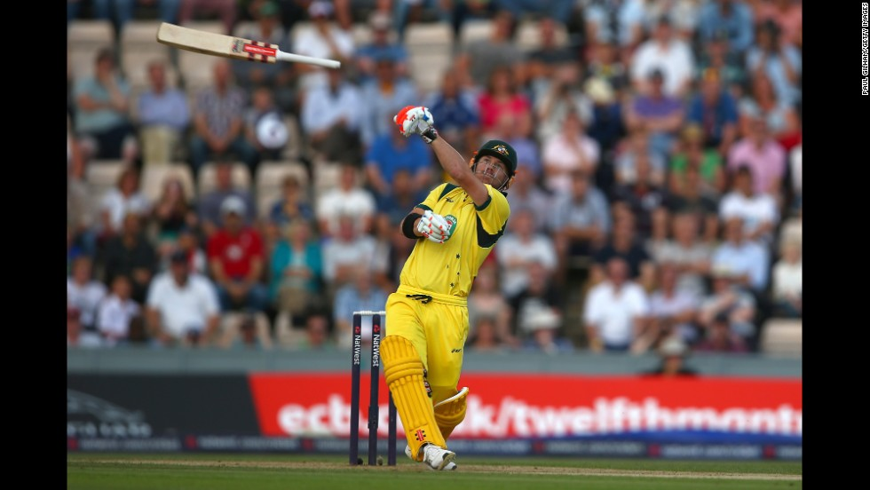 David Warner of Australia lets go of his bat as he hits the ball only to be caught out by Jos Buttler of England during the 1st NatWest Series T20 match between England and Australia on August 29 at the Ageas Bowl in Southampton, England.