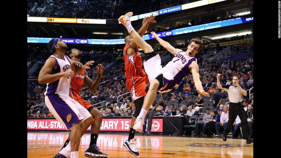 Goran Dragic of the Phoenix Suns falls to the court after being fouled by Caron Butler of the Los Angeles Clippers on January 24 at US Airways Center in Phoenix. The Suns won 93-88.