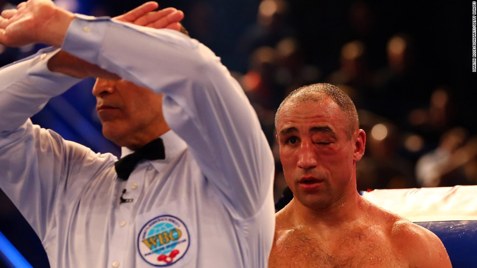 The referee stops Robert Stieglitz and Arthur Abraham of Germany during the WBO World Championship Super Middleweight title fight on March 23 at Getec Arena in Magdeburg, Germany.