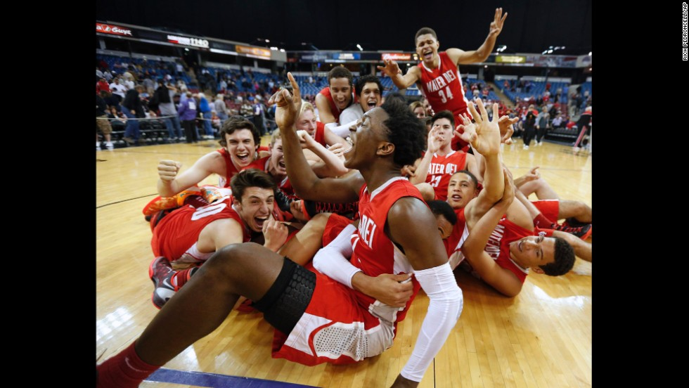 Mater Dei players celebrate after defeating Archbishop Mitty 50-45 in the CIF Boys Open Division State Basketball Championship game on March 23 in Sacramento, California.