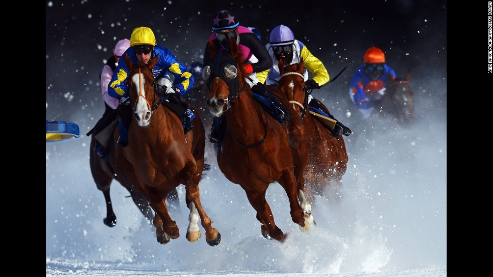 Tepmokea, ridden by Shane Kelly, leads the field into the final turn during the Grand Prix Guardaval Immobilien race at the White Turf horseracing meeting on the frozen Lake St. Moritz on February 3 in St. Moritz, Switzerland.