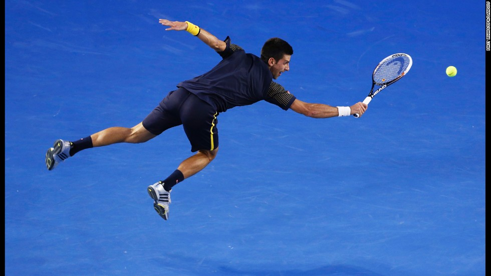 Novak Djokovic of Serbia hits a backhand during the men's final against Andy Murray of Great Britain at the Australian Open Grand Slam tennis tournament on January 27 in Melbourne, Australia.