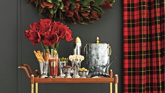 This bar cart gets a holiday treatment with silver bowls and an arrangement of amaryllis, but could easily transition to everyday decor.