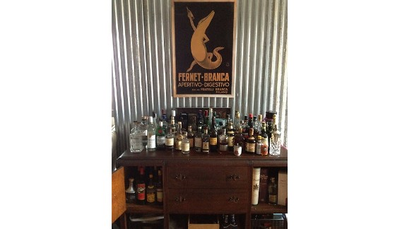 Steva Casey, bar manager at Veranda on Highland in Birmingham, Alabama, made a bar from an antique sideboard placed close to her kitchen for maximum entertaining potential.