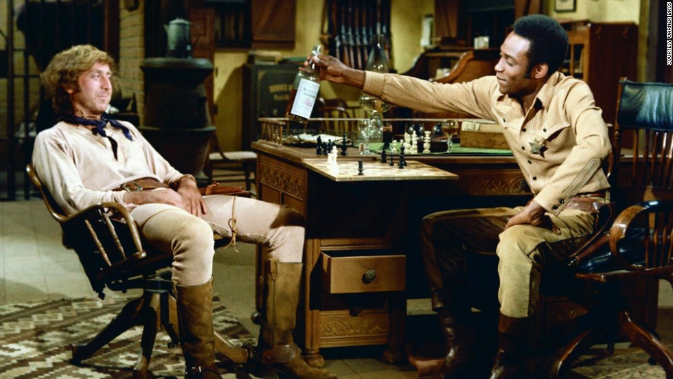 "Director <strong>Mel Brooks</strong> slammed together social satire and daft gags in comedy western ""<strong>Blazing Saddles""</strong> (1974). The film brought new life to the slapstick genre and went places comedies would not have dared in the ""golden age"" (try to imagine Buster Keaton punching a horse). These jokes may have been gently mocking slapstick's fondness for cartoonish violence, but the film could not have ended on a more traditional note -- with the characters breaking into <a href=""http://www.tcm.com/mediaroom/video/197362/Blazing-Saddles-Original-Trailer-.html"" target=""_blank""><strong>an enormous pie fight</a></strong>."