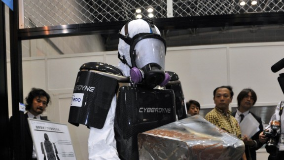 """Also developed in the wake of the Fukushima nuclear disaster, this protective suit allows emergency services to act very quickly in the event of a nuclear meltdown. The suit's maker's claim that the """"brainwave-controlled"""" exoskeleton allows workers to wear heavy radiation protection without feeling the weight. Sensors detect signals from the brain and the robot's limbs move in tandem with the wearer's, taking weight off the muscles. It is the creation of Japanese tech firm Cyberdyne, who initially developed the technology to help assist people with disabilities."""