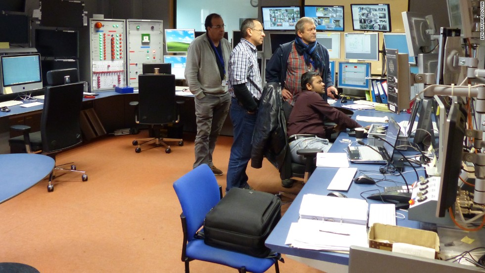 Physicists work in the CMS control room.