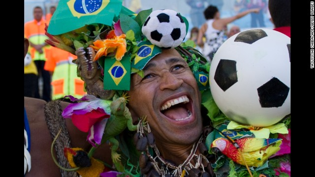 A Brazilian fan laughs at Maracana stadium before a FiFA World Cup Brazil 2014 friendly football match between Brazil and England in Rio de Janeiro, Brazil, on June 2, 2013. AFP PHOTO/Yasuyoshi CHIBA        (Photo credit should read YASUYOSHI CHIBA/AFP/Getty Images)