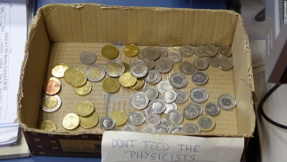"""Don't feed the physicists"" marks a box of coins where CMS scientists deposit change to pay for coffee."