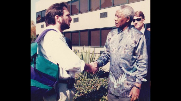 South African President Nelson Mandela shakes hands in 1998 with Tom Cohen, who was leaving South Africa after eight years as an Associated Press correspondent covering the nation's transition from apartheid to a multiracial democracy.