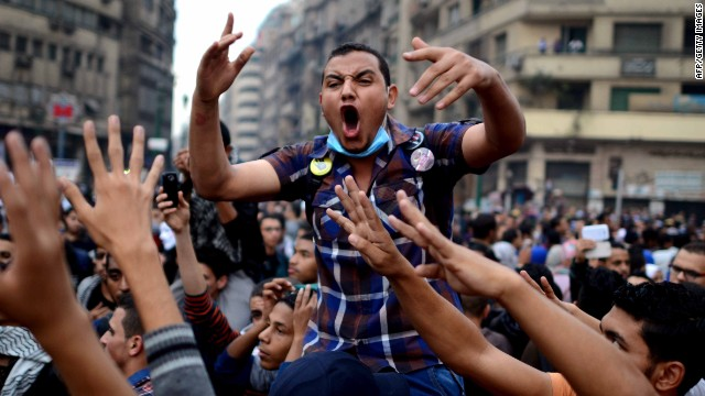 Cairo University's students backing ousted Islamist president Mohamed Morsy in Cairo's Tahrir square on December 1, 2013.