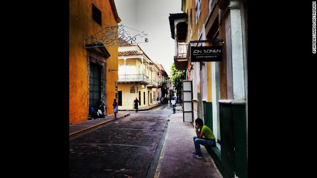 CARTAGENA, COLOMBIA: CNN's Miguel Castro (@sambasando) captures a charming colonial street in the Old Town.  The Old Town, surrounded by massive stone walls, encloses several blocks and hundreds of charming colonial homes, churches, plazas and parks.  It was designated a UNESCO World Heritage Site in 1984.
