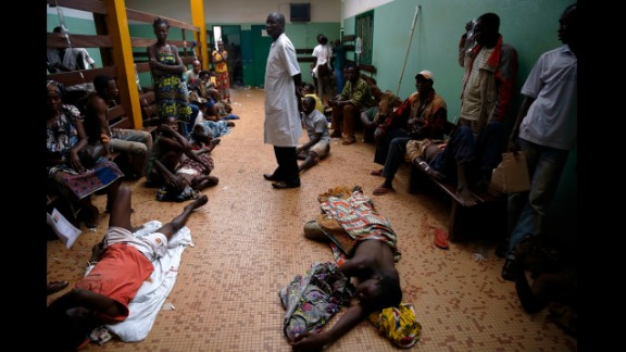 Wounded civilians lie on the floor of Bangui