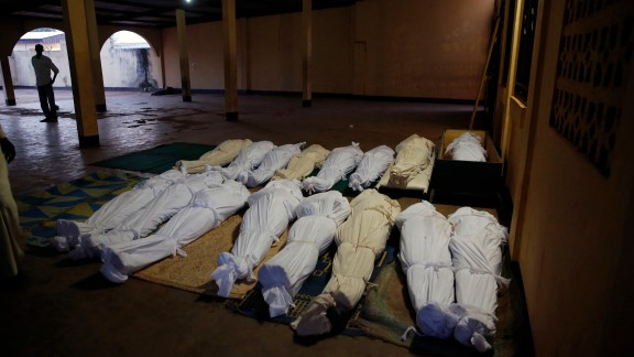 Shrouded bodies are seen in a Bangui mosque December 5.