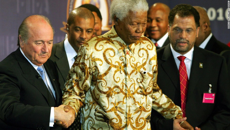 "FIFA President Sepp Blatter seen here with Mandela during preparations for the 2010 World Cup. Blatter paid a glowing tribute to the former South African President on Thursday. ""Nelson Mandela will stay in our hearts forever. The memories of his remarkable fight against oppression, his incredible charisma and his positive values will live on in us and with us,"" Blatter said in a statement."