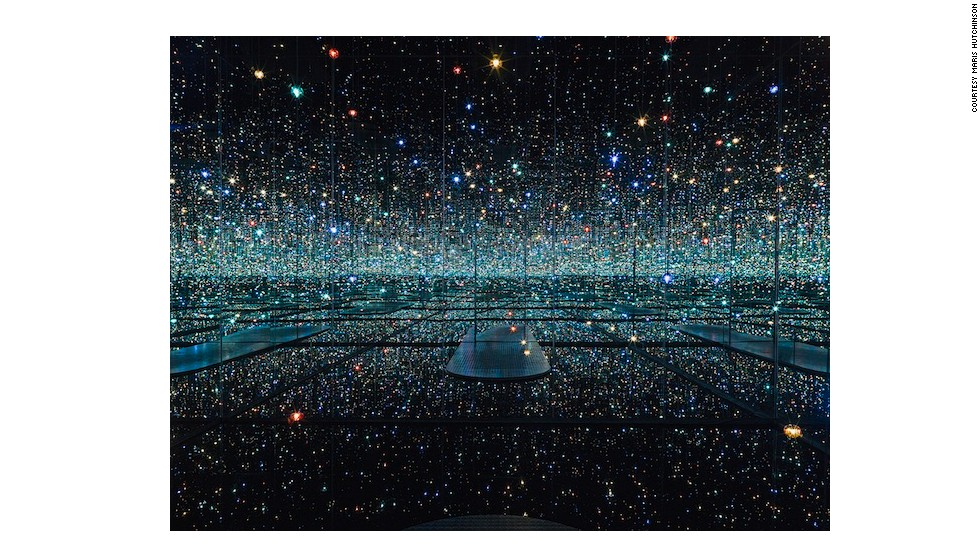<em>The Souls of Millions of Light Years Away</em> (2013) is Yayoi Kusama's newest infinity mirrored room. Multi-colored LEDs dangle from the ceiling at varying lengths.