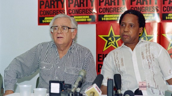"""Joe Slovo (left) was a key negotiator between various anti-Apartheid groups and the ruling National Party. He proposed the breakthrough in the negotiations to end apartheid in South Africa with the """"sunset clause"""" for a coalition government for the five years following a democratic election. He was also the first white elected to the African National Congress leadership."""