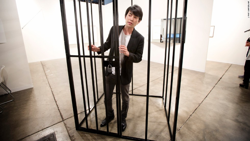 Shohei Shigematsu, from New York, stands inside one of Eduardo Baswaldo's installations on December 4.