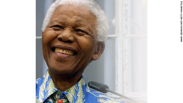 A picture taken on November 28, 2003 shows former South African President Nelson Mandela addressing a press conference in front of his former prison cell on Robben Island, off Cape Town.
