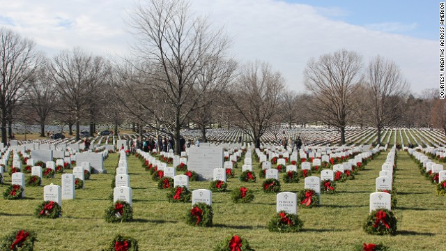 Volunteers lay wreaths at tombstones in Arlington National Cemetery as part of Wreaths Across America on December 15, 2012.