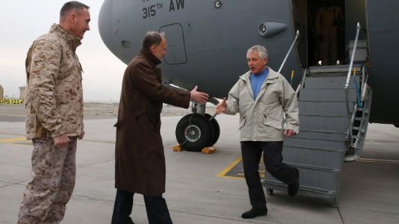 U.S. Secretary of Defense Chuck Hagel (R) arrives on a C17 Military aircraft, on December 7, 2013 in Kabul, Afghanistan.