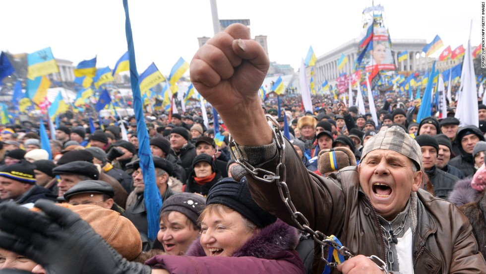 Demonstrators shout slogans during the mass rally on December 8.