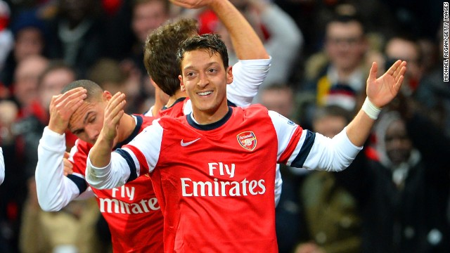 Mesut Ozil celebrates after scoring for Arsenal against Everton but the Merseysiders struck back moments later.