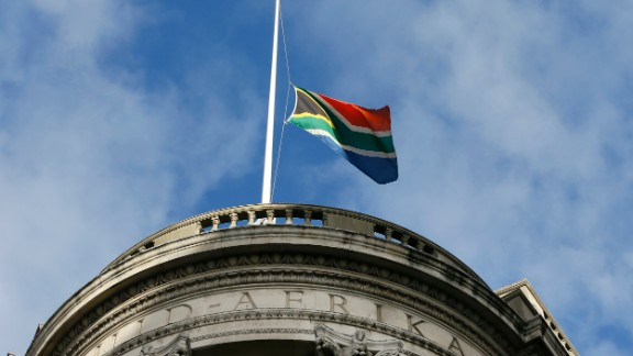 A South African flag flies at half-staff to honor Mandela on December 8 at the South African High Commission in London's Trafalgar Square.
