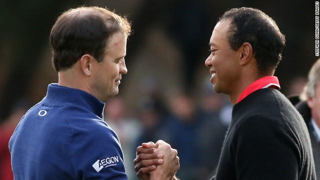 Zach Johnson (left) is congratulated by Tiger Woods following his playoff win against the world no.1 in California.