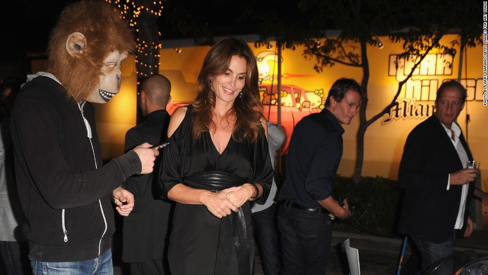 Cindy Crawford, 47, attended a photographic retrospective of her career during Art Basel Miami Beach. Here, she chats with anonymous Swedish artist Herr Nilsson about one of his paintings, which depicts Snow White.