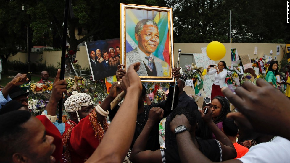 Mourners sing outside the home of former South African President Nelson Mandela in Johannesburg on Monday, December 9. The revered statesman, who emerged from prison to lead South Africa out of apartheid, died on Thursday, December 5. Mandela was 95.