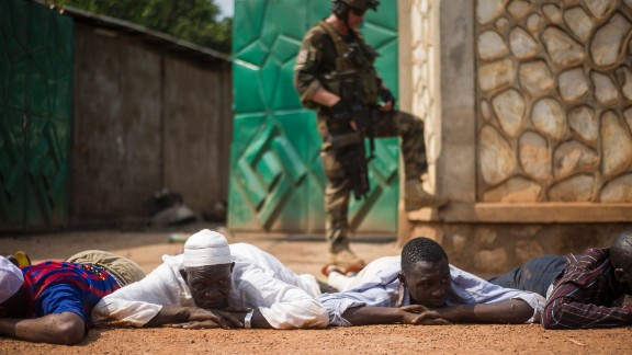 A French soldier stands guard after the arrest of ex-Seleka rebels in a neighborhood near Bangui
