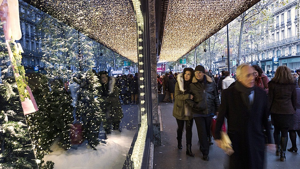 "<strong>""A Joyful Obsession,"" Printemps, Paris:</strong> The Prada Christmas display has 11 windows (four animated, seven high fashion), a 16-meter-long Santa sleigh track and 150 stars and snowflakes."