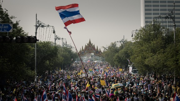 Demonstrators march towards government buildings in Bangkok on December 9 even after Thailand