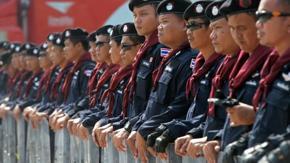 Thai riot police stand guard during a demonstration in Bangkok on December 10.