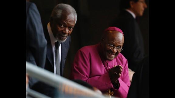 Former Archbishop Desmond Tutu, right, arrives with former U.N. Secretary-General Kofi Annan at FNB Stadium.