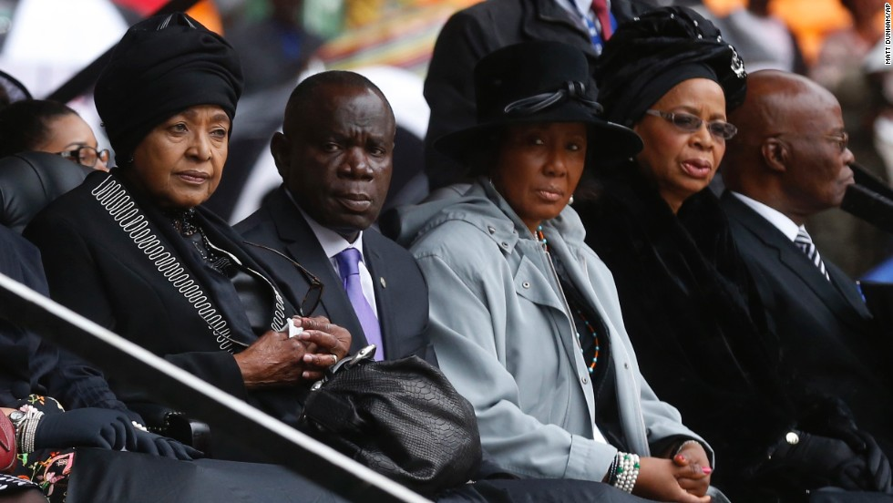Mandela's ex-wife, Winnie Madikizela-Mandela, left, and his widow, Graca Machel, right, sit near each other during the memorial service.