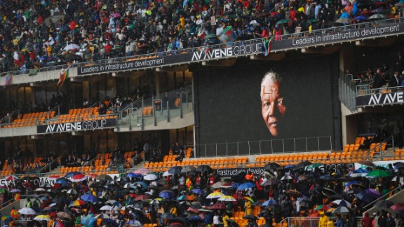 The face of Mandela is shown on a large billboard inside FNB Stadium during the memorial service.