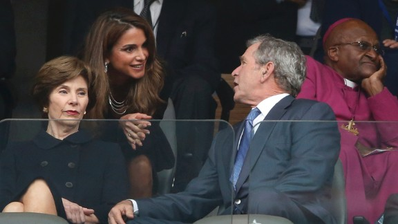 Queen Rania of Jordan speaks with former President George W. Bush and his wife, Laura, during the memorial service.
