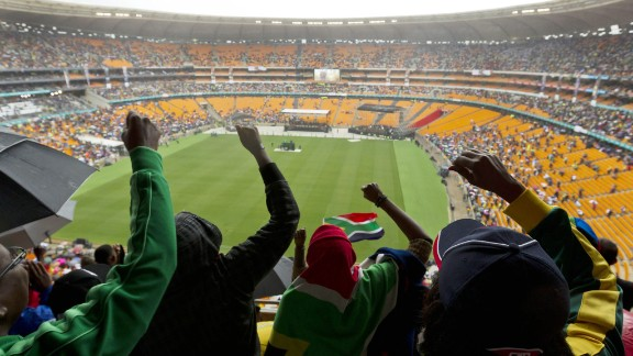 South Africans cheer during the memorial service.