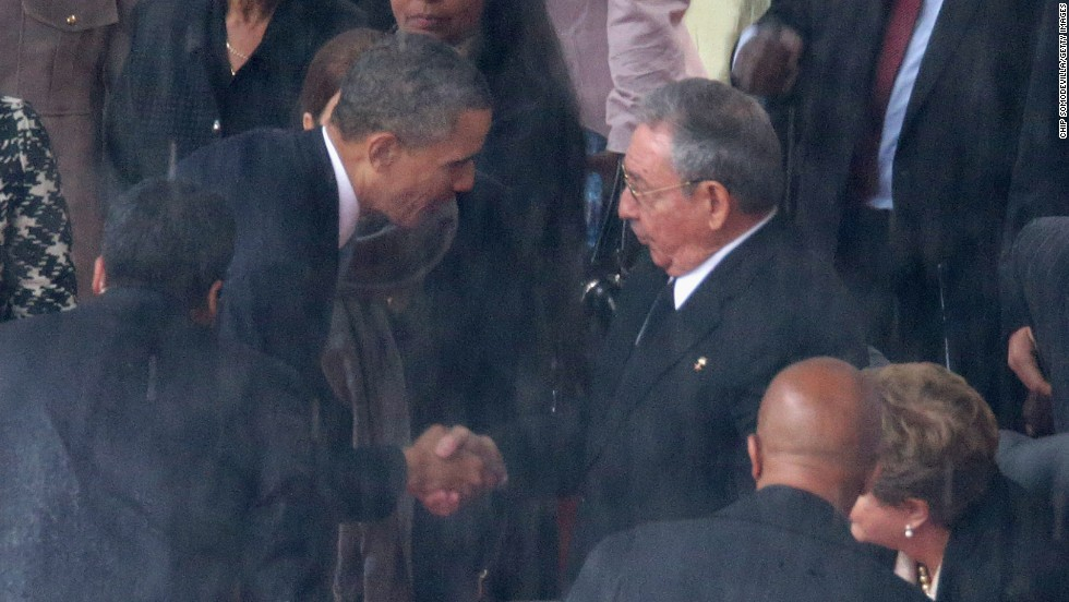 U.S. President Barack Obama shakes hands with Cuban President Raul Castro during the official memorial service for former South African President Nelson Mandela on Tuesday, December 10, in Johannesburg, South Africa. The U.S. and Cuba have not had diplomatic relations since the Cuban Revolution more than 50 years ago. Click through the gallery for more handshakes that have made history: