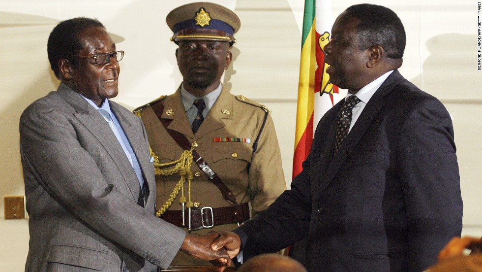 Zimbabwean President Robert Mugabe, left, shakes hands with Movement for Democratic Change leader Morgan Tsvangirai on July 21, 2008, in Harare after the signing of a deal between Zimbabwe's opposition and ruling party, paving the way for full-scale talks.