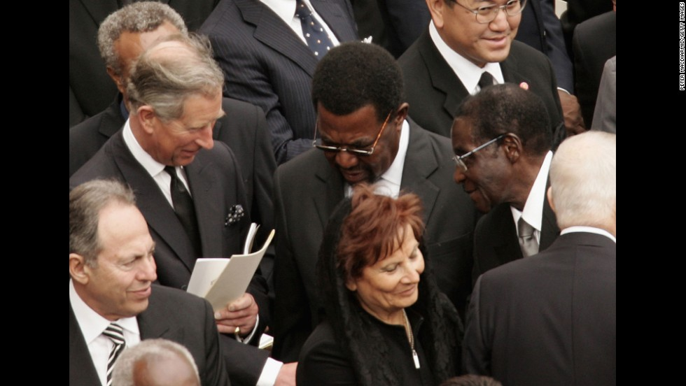 Prince Charles shakes hands with Zimbabwe's President Robert Mugabe during Pope John Paul II's funeral in St. Peter's Square on April 8, 2005, in Vatican City.