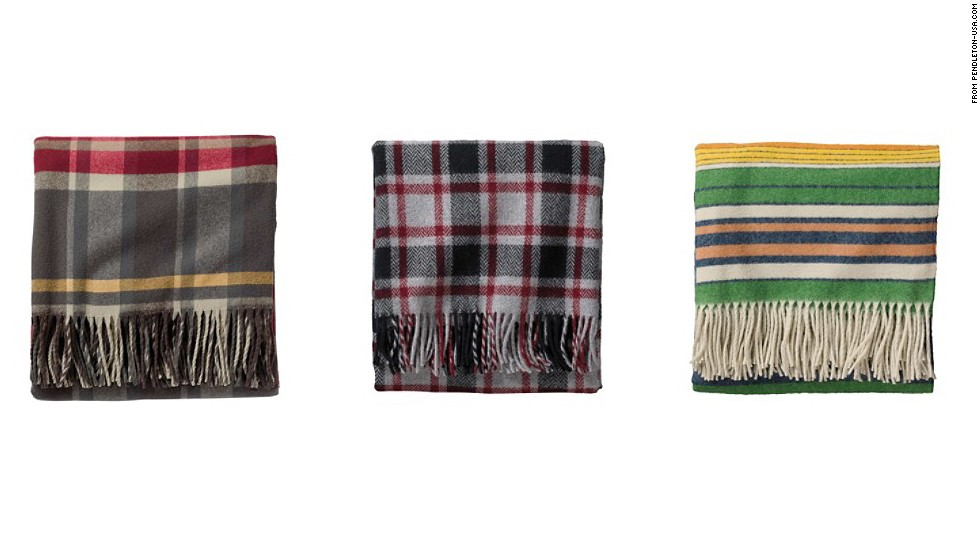 "A holiday gift for the boss can be especially challenging. We suggest a stylish gift that reflects current trends. Heritage American companies like Pendleton are making a comeback in 2013; one of these <a href=""http://www.pendleton-usa.com/category/Home-Blankets/Throws/1822/pc/1816.uts"" target=""_blank"">Pendleton sofa throws</a> would be a great gift for the boss."