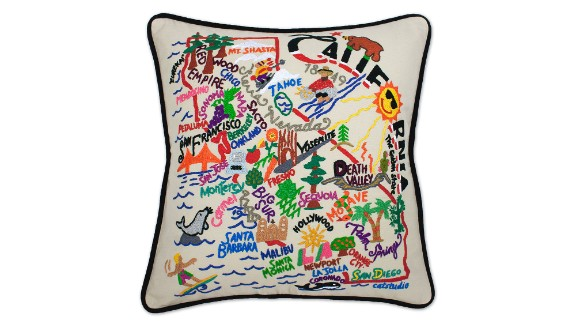 """The people who work with you at home -- babysitters, housekeepers and nannies -- often develop strong ties to your family. Choose gifts for them that play up your connection, like embroidered throw pillows from <a href=""""http://www.uncommongoods.com/product/hand-embroidered-state-pillows?utm_medium=cpc&utm_source=google&gclid=CJeEk6S3prsCFfPm7AodDHcAGw"""" target=""""_blank"""" target=""""_blank"""">Uncommon Goods</a> that celebrate the state where you live."""
