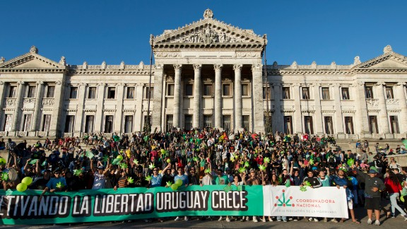 Supporters of legalizing marijuana demonstrate outside Uruguay's Senate.